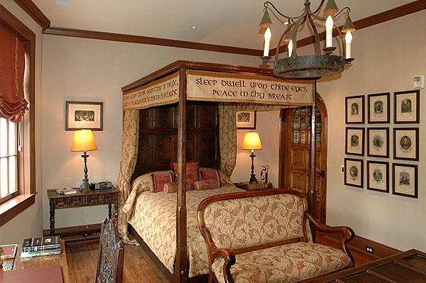 Oak panelled tester bed in the Shakespeare room of a prestigious hotel.