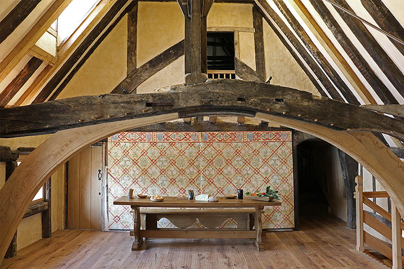 The floored over great hall, with our 16th century style oak trestle table and bench