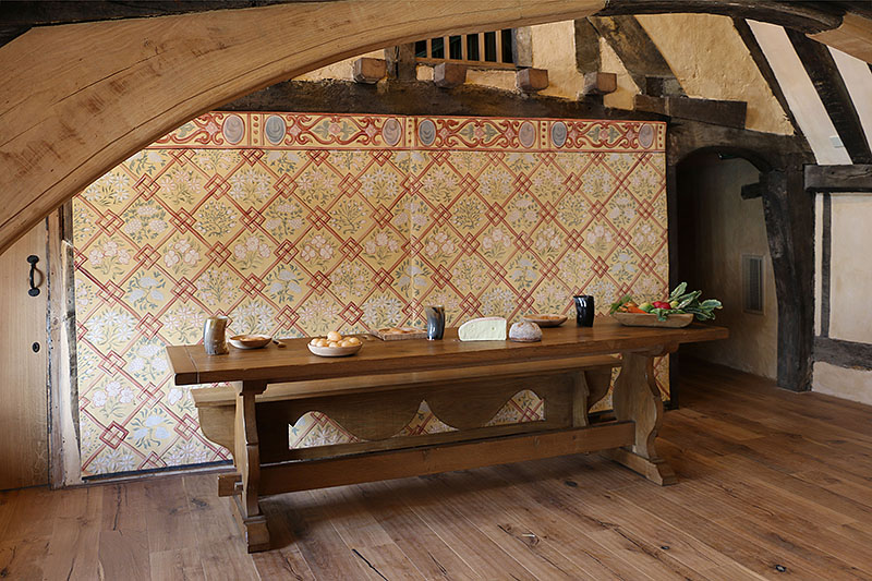 Our 16th century style oak trestle table and form, in the floored over great hall