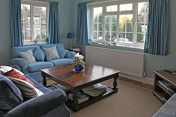 Large square oak potboard coffee table in sitting room of Sussex home.