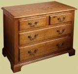 Double width 4-drawer traditional style oak bedside cabinet