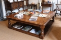 Large square oak potboard coffee table in showroom
