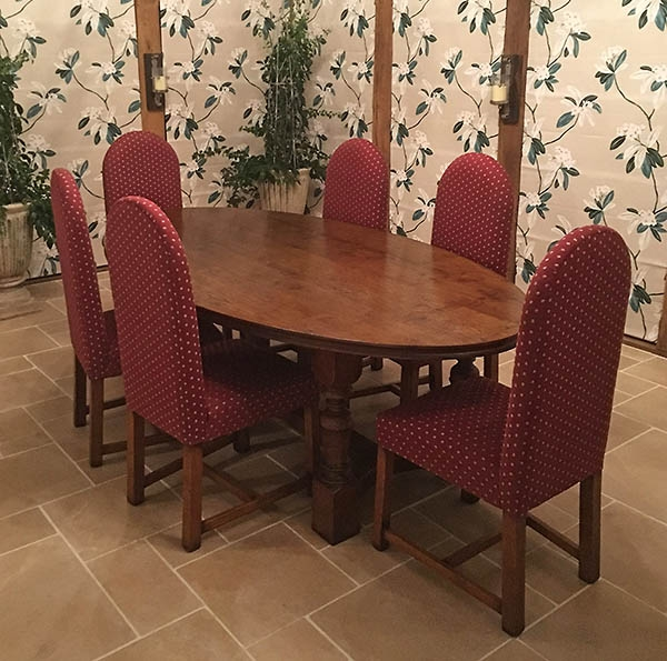 Oval top oak refectory table with upholstered chairs