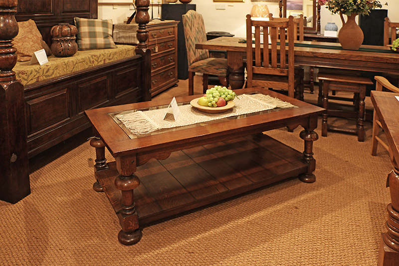 Traditional style oak pot-board coffee table with glass top