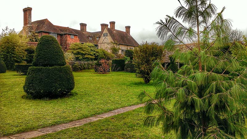 Great Dixter rear elevations, as seen from the Topiary Lawn