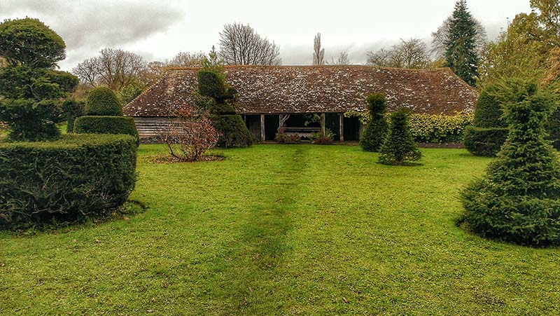 The old cow shed from the Topiary Garden in the grounds of Great Dixter