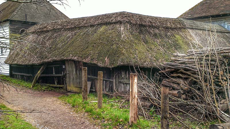 Thatched outbuilding between the Great Barn and ancillary farm buildings of Great Dixter