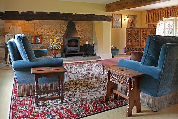 Period style oak stools in country house sitting room