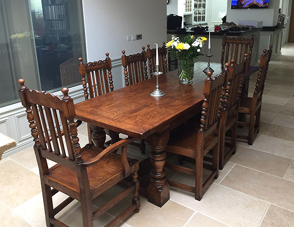 Period style oak refectory table and carved dining chairs in Cambridge kitchen