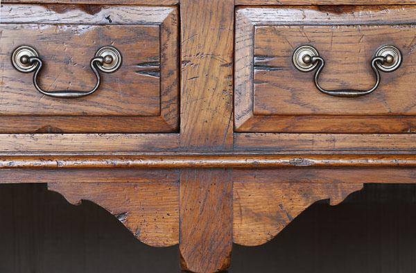 Period style oak dresser base drawer and bracket detail