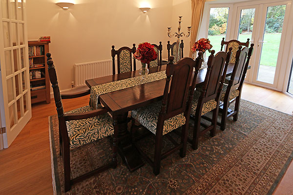 Period style oak table and chairs in Kent home