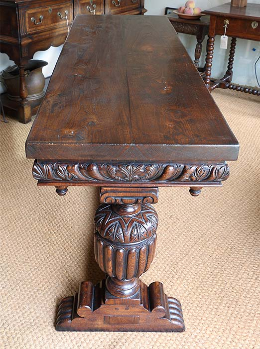 Elizabethan style carved oak console table in showroom