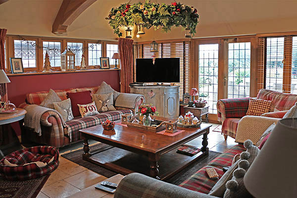 Large pot board coffee table in morning room of Sussex home