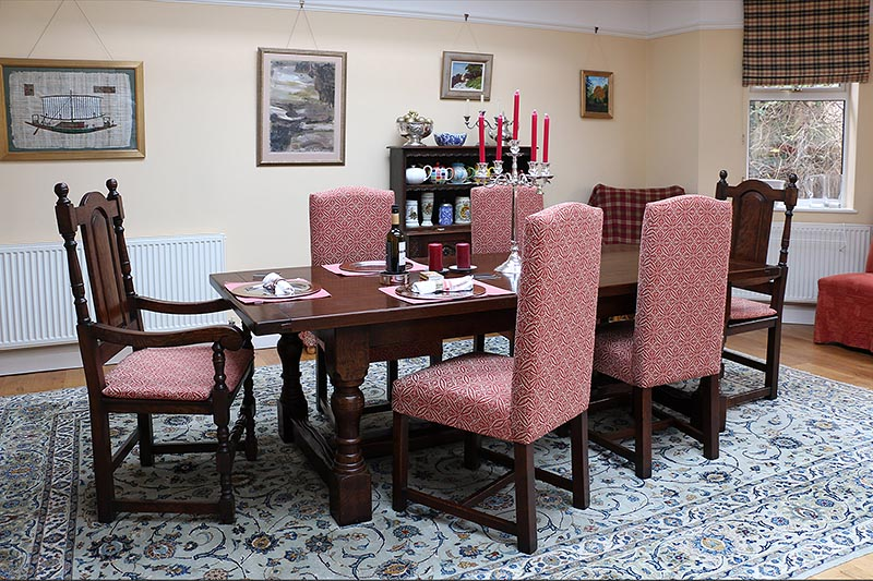 Mixing antique style solid seat oak carvers and fully upholstered oak side chairs
