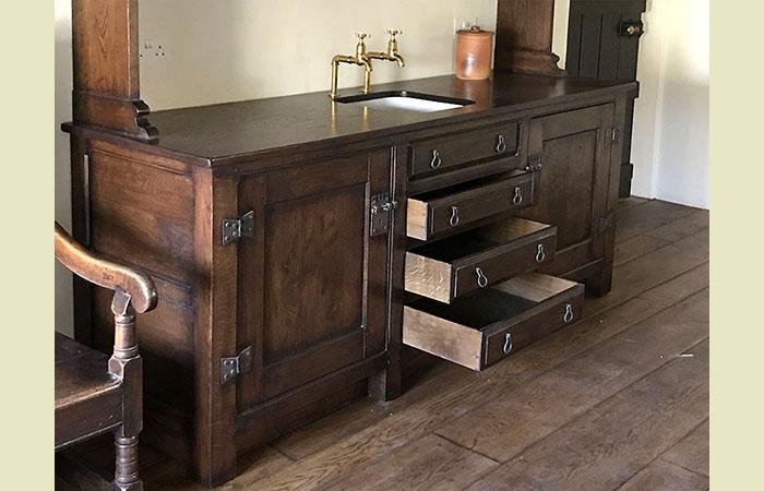 Oak kitchen dresser with drawers under sink