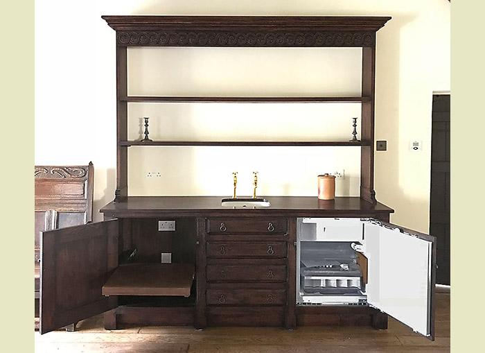Oak kitchen dresser with integrated fridge and microwave shelf