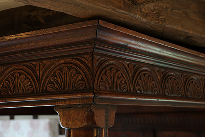 17th century style carved oak tester bed cornice detail