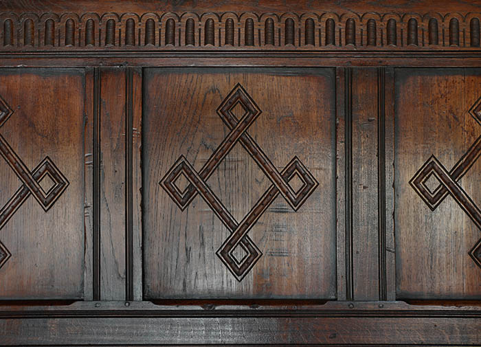 17th century style carved oak tester bed headboard detail
