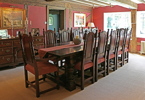 Period style carved oak table & chairs in C16th house