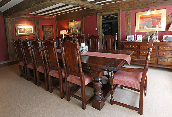 Period style oak table and chairs in 16th century timber framed interior