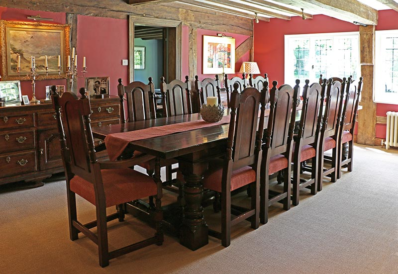 Period style oak table and chairs in 16th century house