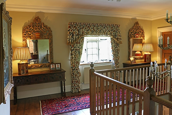 Antique style carved mirrors in Warwickshire country home
