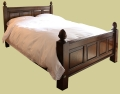 Oak bed with fielded panels and acorn finials