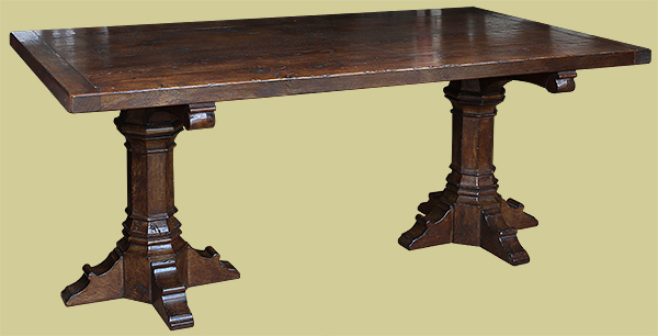 Medieval style carved oak trestle table