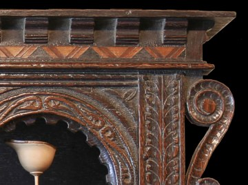 Detail of glass case showing hand moulded corbels and parquetry inlay